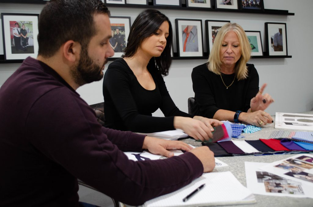 Total image Group Team working on design, looking at fabrics and styles