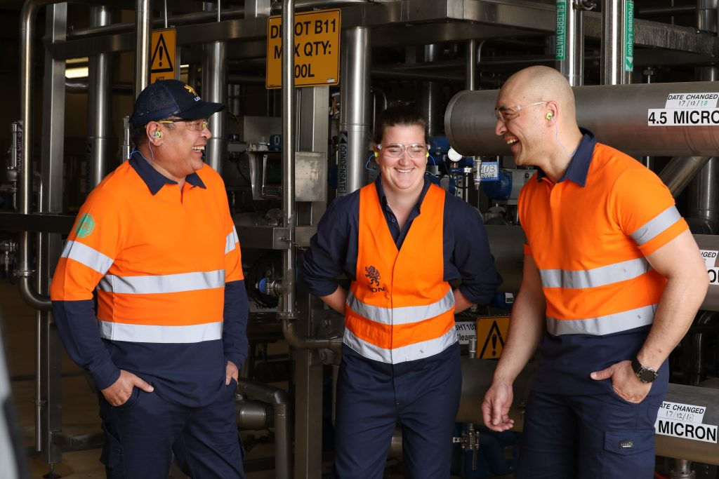 Three Lion Co. Employees in hi-vis workwear laughing