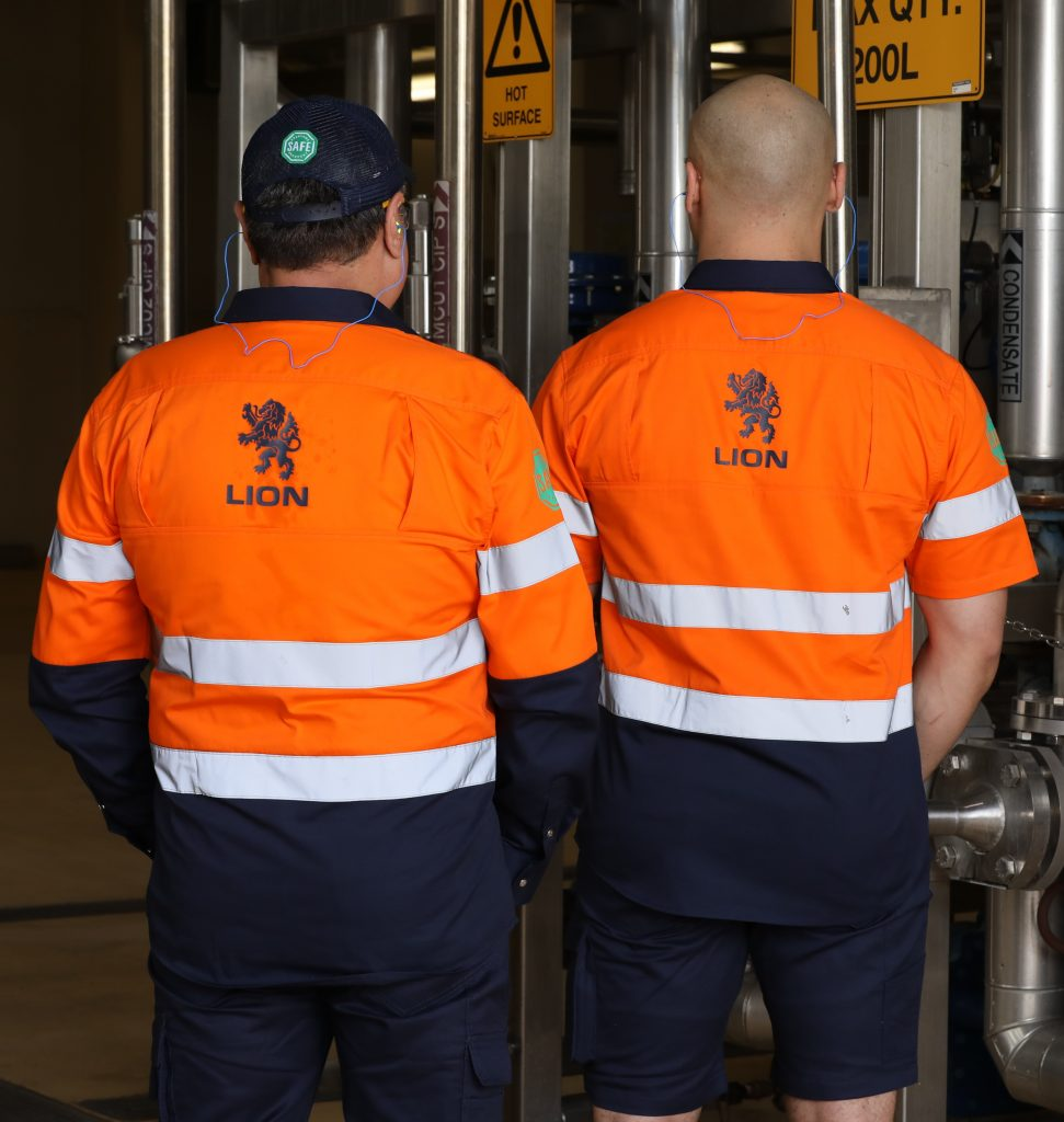 Lion Co. Employees in branded hi-vis workwear facing away from camera