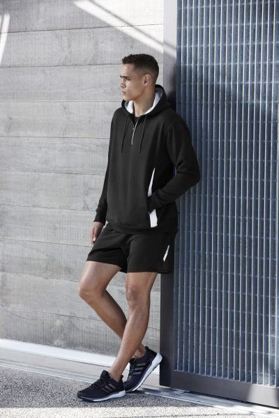 Biz Collection Man standing against wall in activewear
